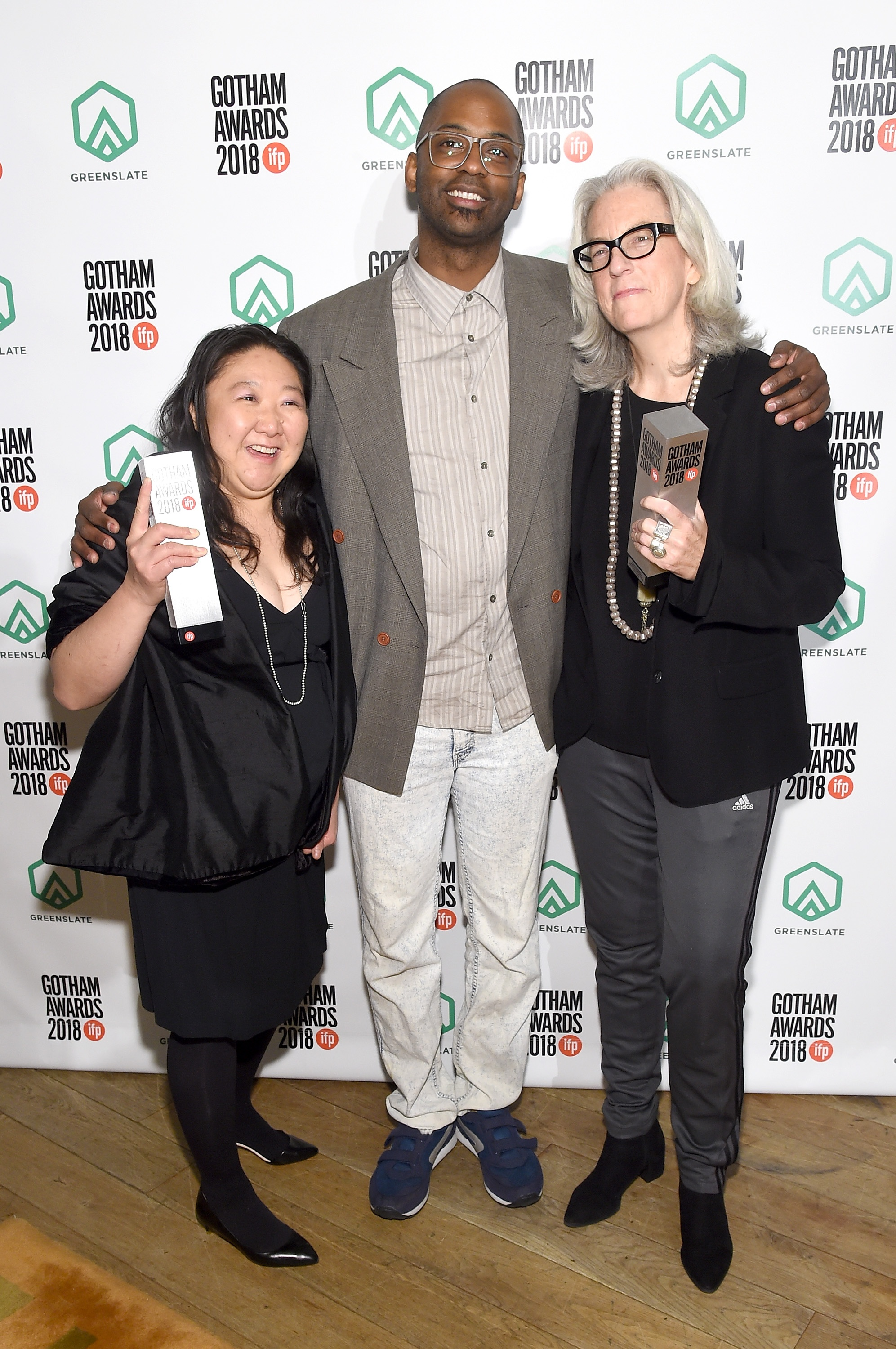 Su Kim, RaMell Ross, and Joslyn Barnes backstage in the GreenSlate Greenroom during IFP's 28th Annual Gotham Independent Film Awards at Cipriani, Wall Street on November 26, 2018 in