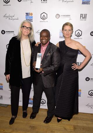 Producer Joslyn Barnes and Director/Producer Yance Ford with their Strong Island Best Documentary Award and Cynthia Nixon in the GreenSlate Greenroom at the 2017 Gotham Awards in New York City