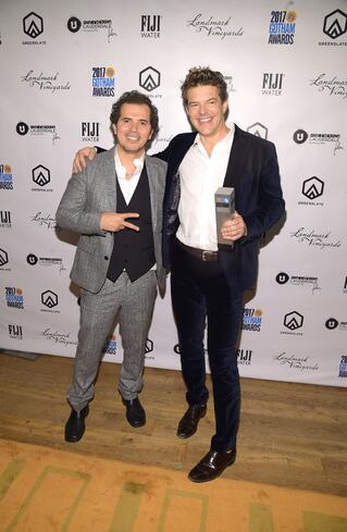 Actor John Leguizamo and Producer Jason Blum with Blum's Gotham Tribute Award in the GreenSlate Greenroom at the 2017 Gotham Awards in New York City