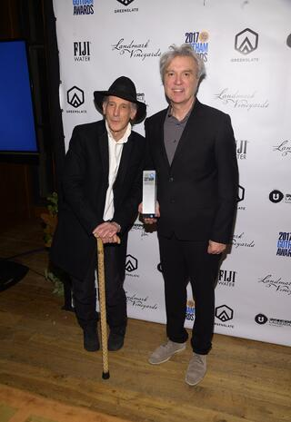 Ed Lachman and David Byrne with Lachman's Gotham Tribute Award in the GreenSlate Greenroom at the 2017 Gotham Awards in New York City