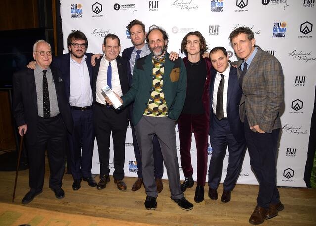 Director Luca Guadagnino and the cast of Call Me by Your Name with Call Me by Your Name's Best Feature Award in the GreenSlate Greenroom at the 2017 Gotham Awards in New York City